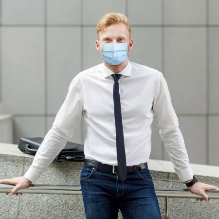 Bør dine ansatte bruke munnbind på arbeidsplassen?